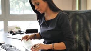Woman Looking at Paycheck