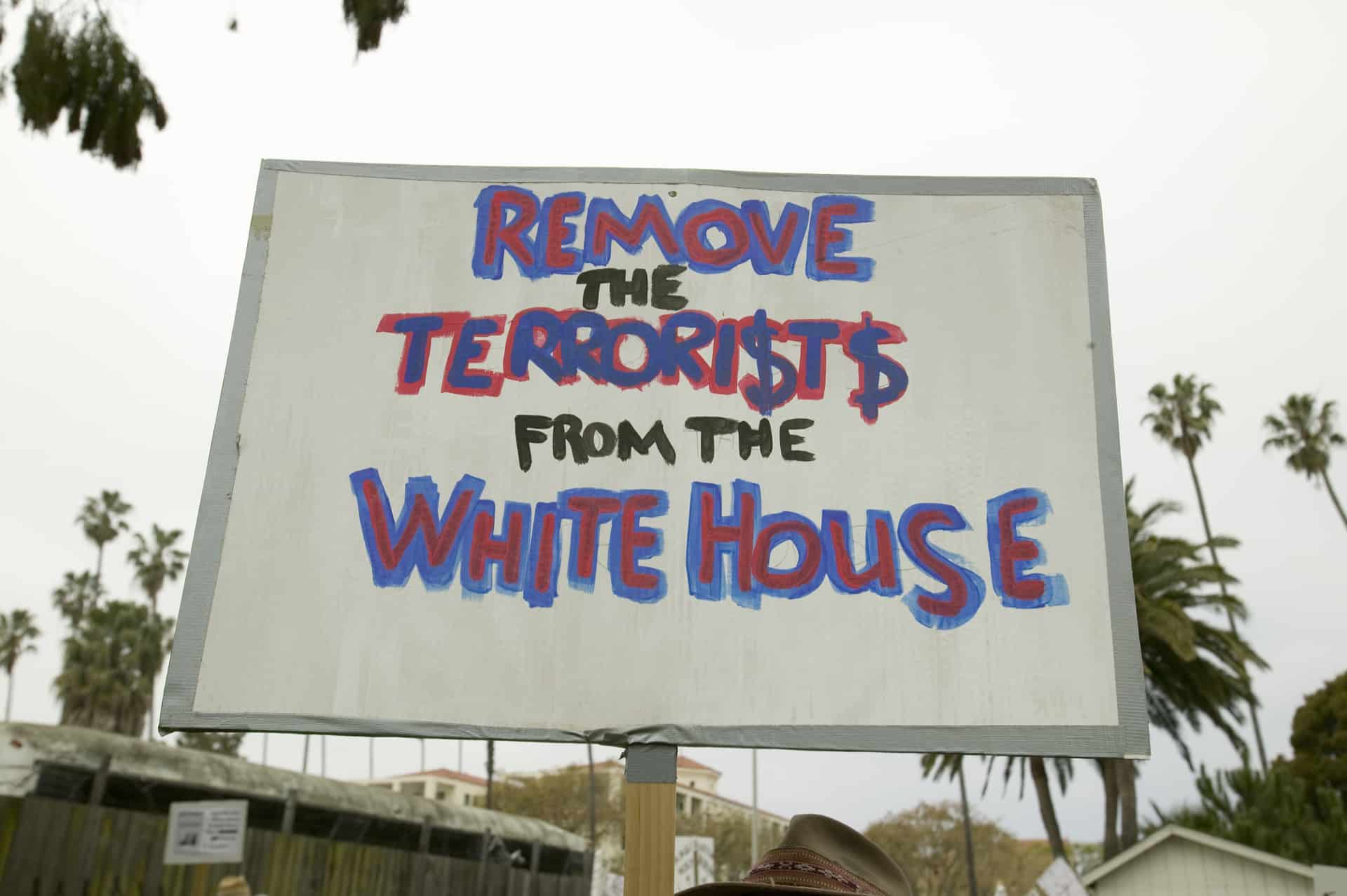 "Sign that says ""Remove the TERRORI$T$ from the White House"""