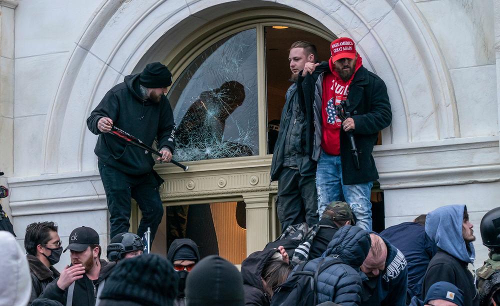 Protestors breaking Capitol Building windows