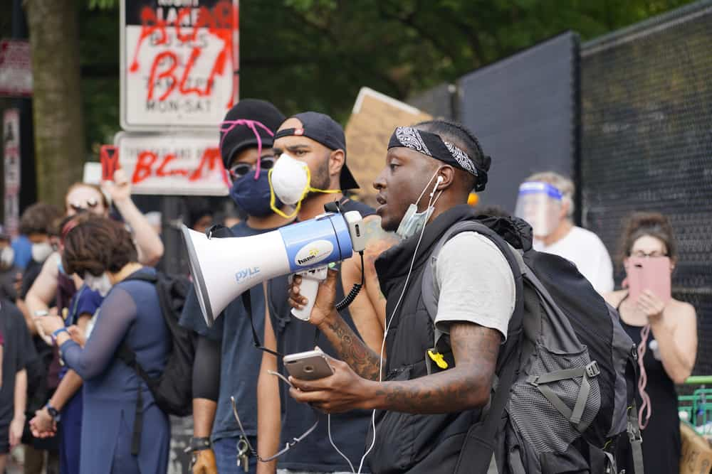 Black Protester with a Megaphone