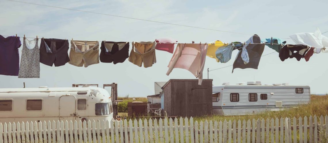 Clothesline blowing in a breeze in front of Trailers