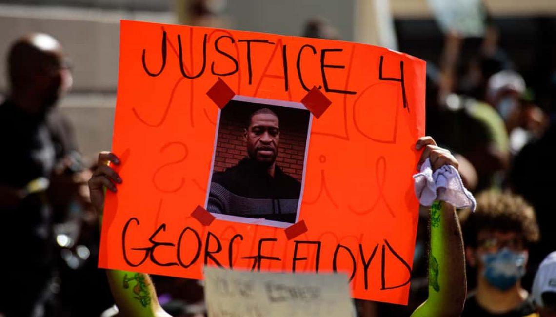 Sign stating JUSTICE 4 GEORGE FLOYD