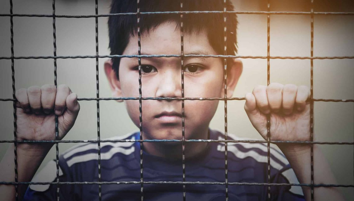Separated Child behind Fence